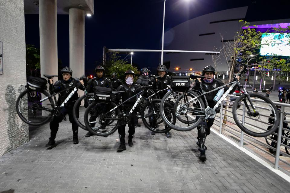 Police use bikes as weapons during protests